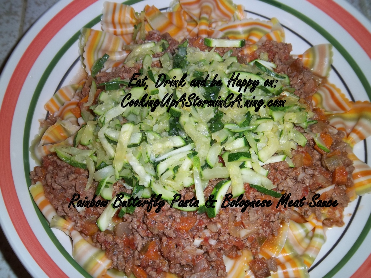 Rainbow Farfalle with Bolognese and Julienne Zucchini & Basil